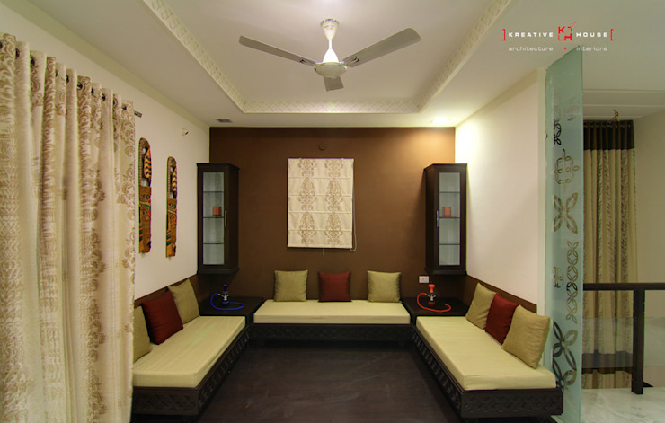 A TRIPLEX VILLA NEAR SUNCITY, HYDERABAD Modern living room by KREATIVE HOUSE Modern