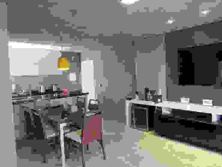 Salas de jantar industriais por Escritório de Arquitetura Cláudia Mendonça Industrial