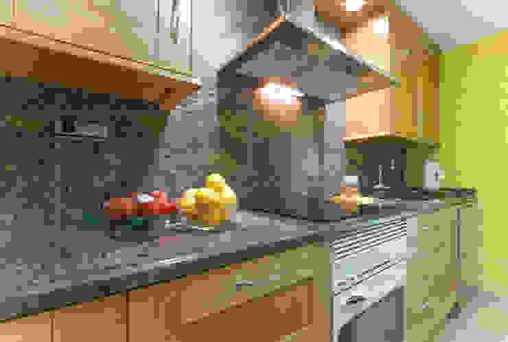 Detalles en una cocina ordenada Cocinas eclécticas de Marca de Casa Ecléctico Granito
