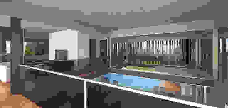 CASA DE HORMIGÓN - Autores: Mauricio Morra Arq., Diego Figueroa Arq. Livings modernos: Ideas, imágenes y decoración de Mauricio Morra Arquitectos Moderno
