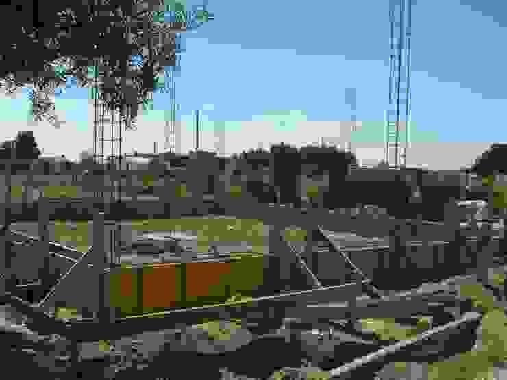 Execução de vigas de fundação. Casas campestres por knowhowtobuild Campestre