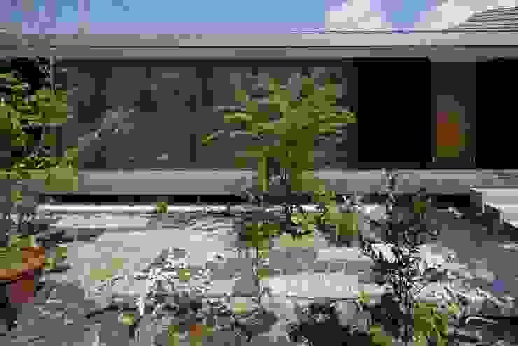 Дома в эклектичном стиле от 澤村昌彦建築設計事務所 Эклектичный