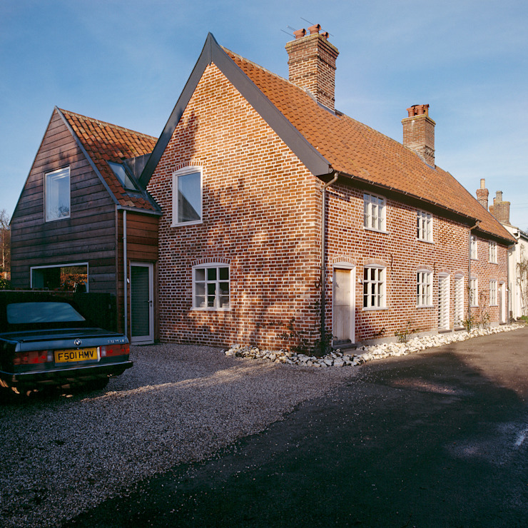 Exterior of the Old Hall in Suffolk Modern houses by Nash Baker Architects Ltd Modern Bricks