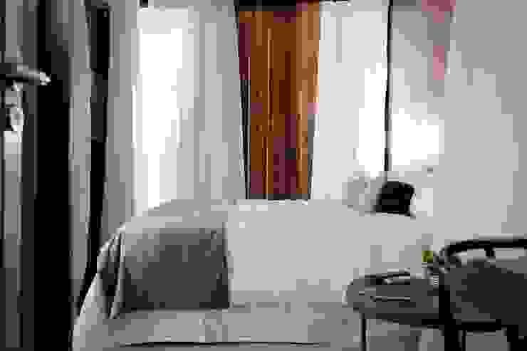 Dormitorios de estilo moderno de T + T Arquitectos Moderno