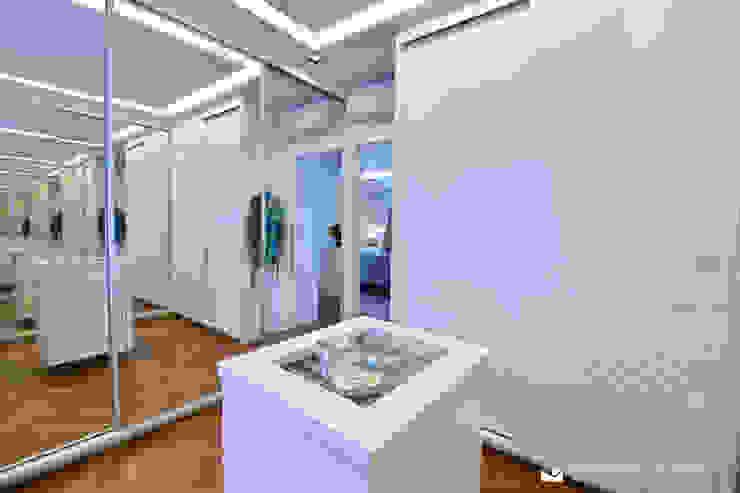 Vestidores de estilo moderno de Tania Bertolucci de Souza | Arquitetos Associados Moderno