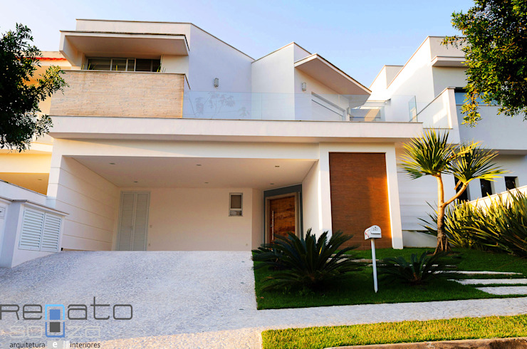 Modern home by Renato Souza Arquitetura Modern