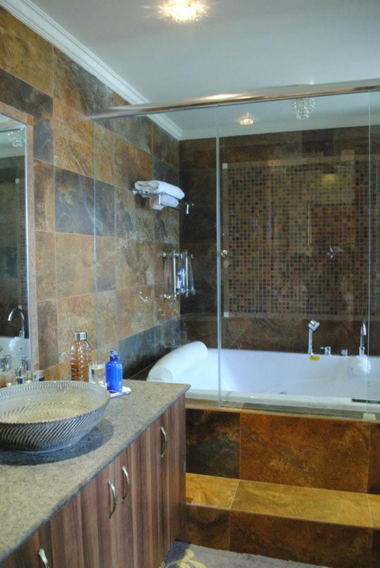 Modern bathroom by Construction Associates Modern