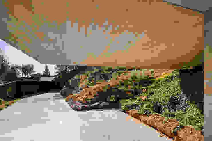 Refúgio na Montaria: Jardins  por Carvalho Araújo,Moderno Betão