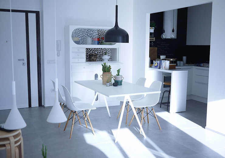 Industrial style dining room by Giulia Brutto Architetto Industrial