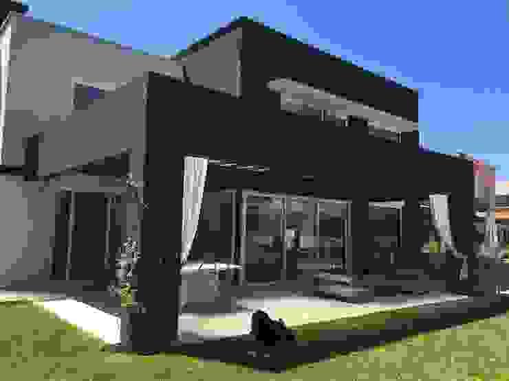 Casas modernas de MFARQ - Tomas Martinez Frugoni Arq Moderno