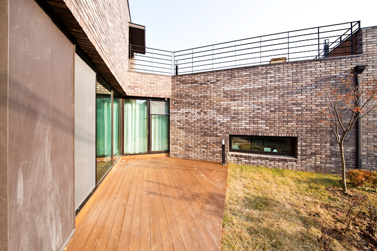 Balcon, Veranda & Terrasse modernes par GongGam Urban Architecture & Construction Moderne