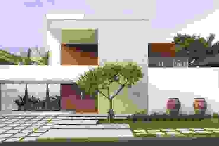 Houses by FERNANDO ROMA . estudioROMA, Modern