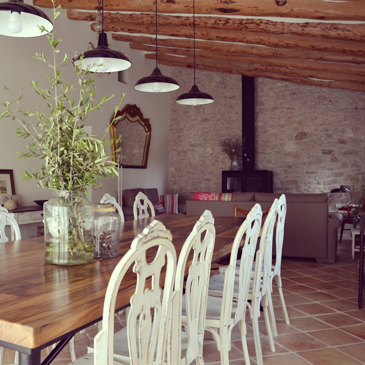 Country style dining room by raddi ARQUITECTES Country