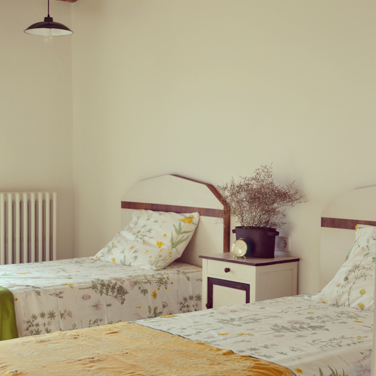 Country style bedroom by raddi ARQUITECTES Country