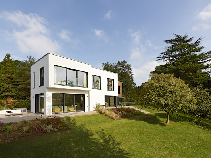 Exteriors Modern houses by Baufritz (UK) Ltd. Modern