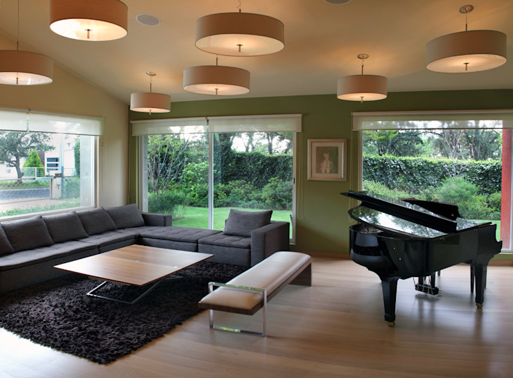 Casa Uliva Salones modernos de DIN Interiorismo Moderno