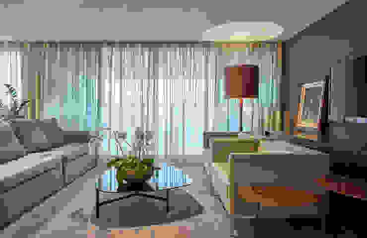 Apartamento Vila da Serra II: Sala de estar  por Juliana Goulart Arquitetura e Design de Interiores
