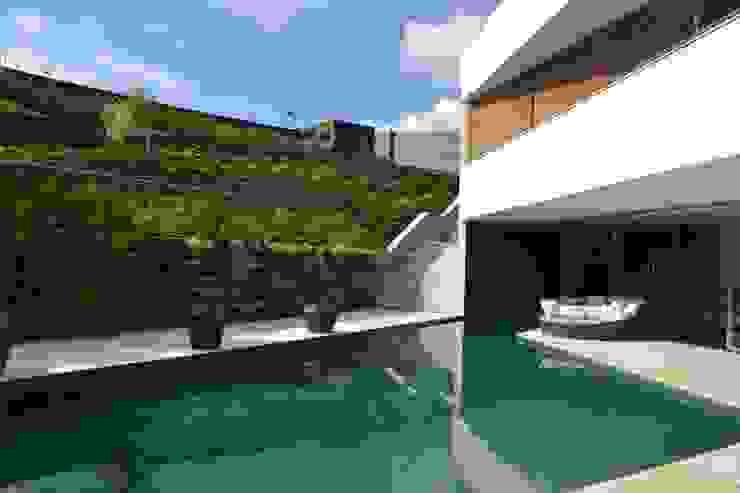 ÁREA EXTERNA Piscinas modernas por Juliana Goulart Arquitetura e Design de Interiores Moderno
