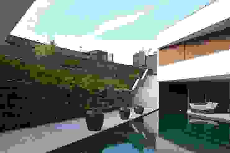 AREA DE LAZER - PISCINA Piscinas modernas por Juliana Goulart Arquitetura e Design de Interiores Moderno