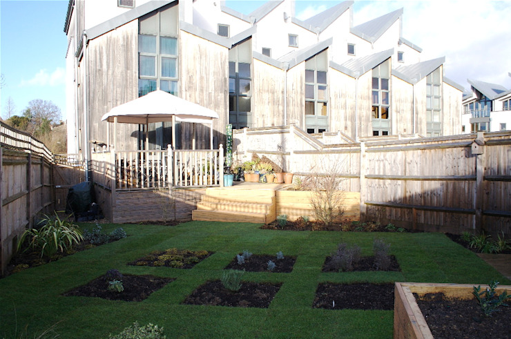Photo from the rear of the garden towards the elevation of the new development Modern garden by Cowen Garden Design Modern