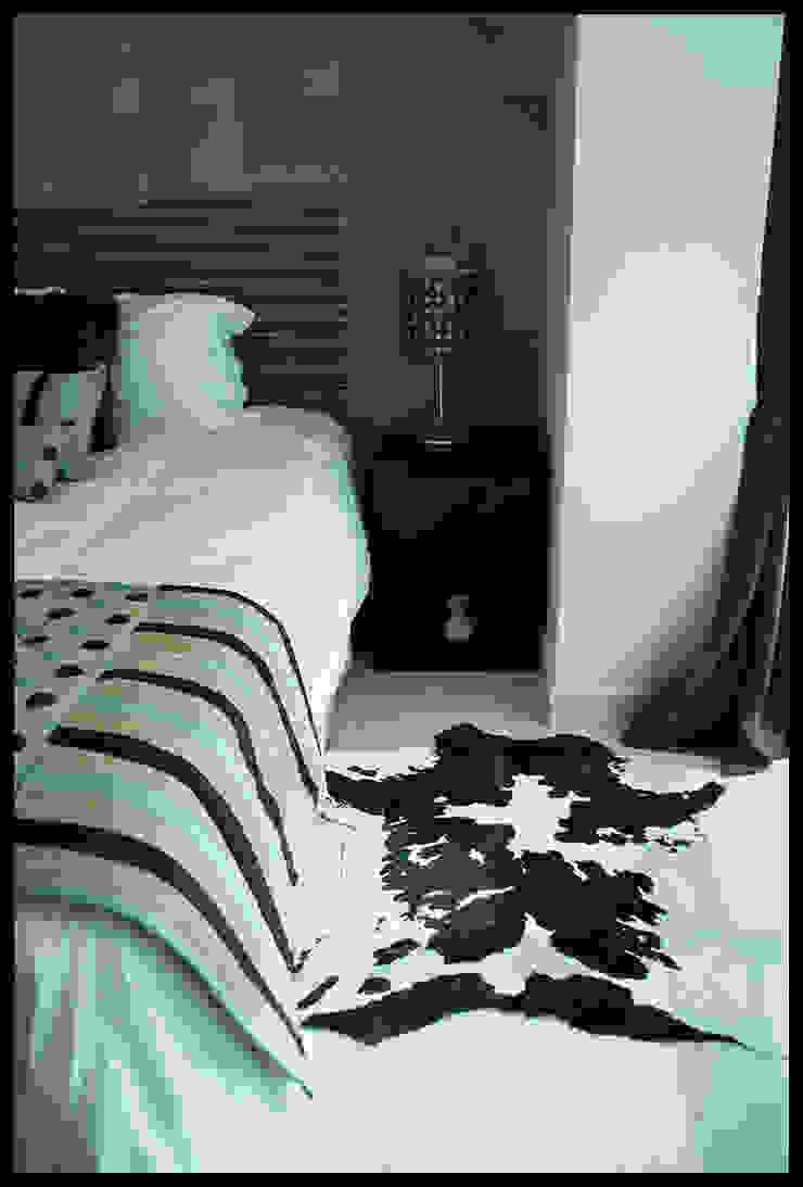 Dormitorio con sello propio de Diseñadora Lucia Casanova Ecléctico