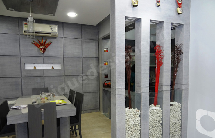 Mr. Juneja House Modern dining room by UNIQUE DESIGNERS & ARCHITECTS Modern