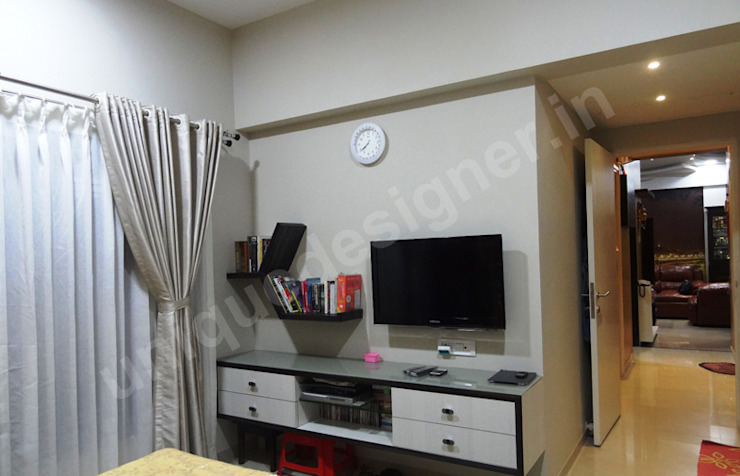 Mr. Arjit Sarkar Modern style bedroom by UNIQUE DESIGNERS & ARCHITECTS Modern