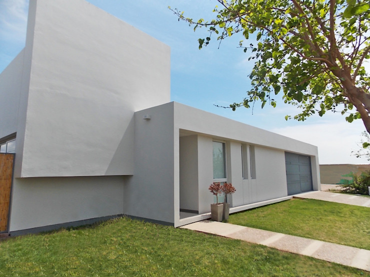 CASA VC Casas modernas: Ideas, imágenes y decoración de Aurea Arquitectura y Amoblamientos Moderno