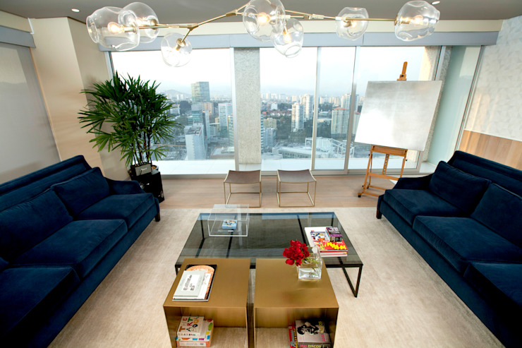 Phòng khách phong cách chiết trung bởi MAAD arquitectura y diseño Chiết trung