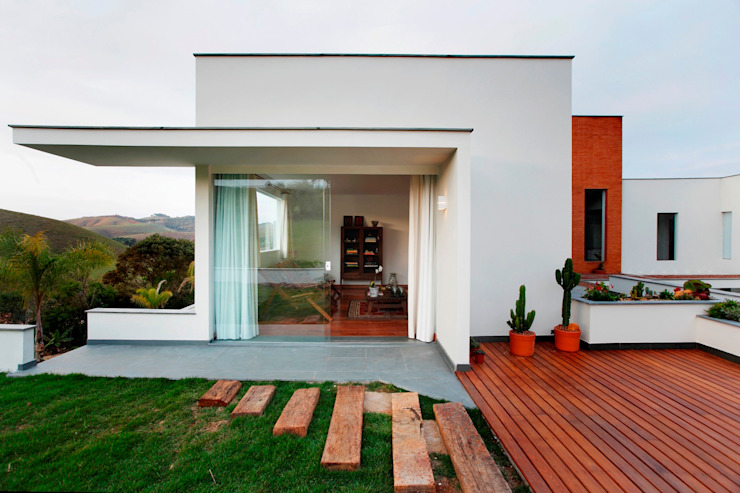 Modern houses by Carlos Salles Arquitetura e Interiores Modern