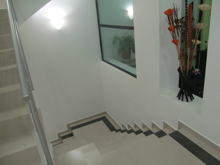 CASA ORAN-GE (habitacional +servicio) de 1001 ESTUDIO / Arquitectura