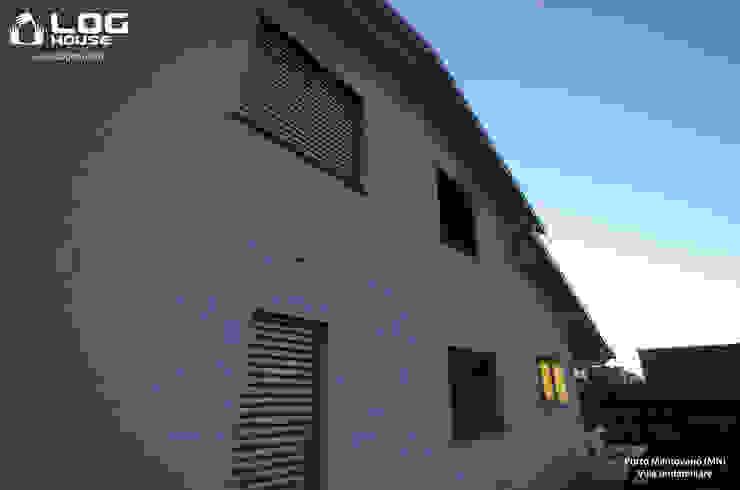 Un gioco di volumi e luci per una villa unica dal retrogusto palladiano. LOG HOUSE
