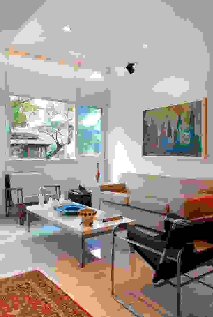 Apartamento Ipanema 3 Salas de estar ecléticas por Carlos Salles Arquitetura e Interiores Eclético