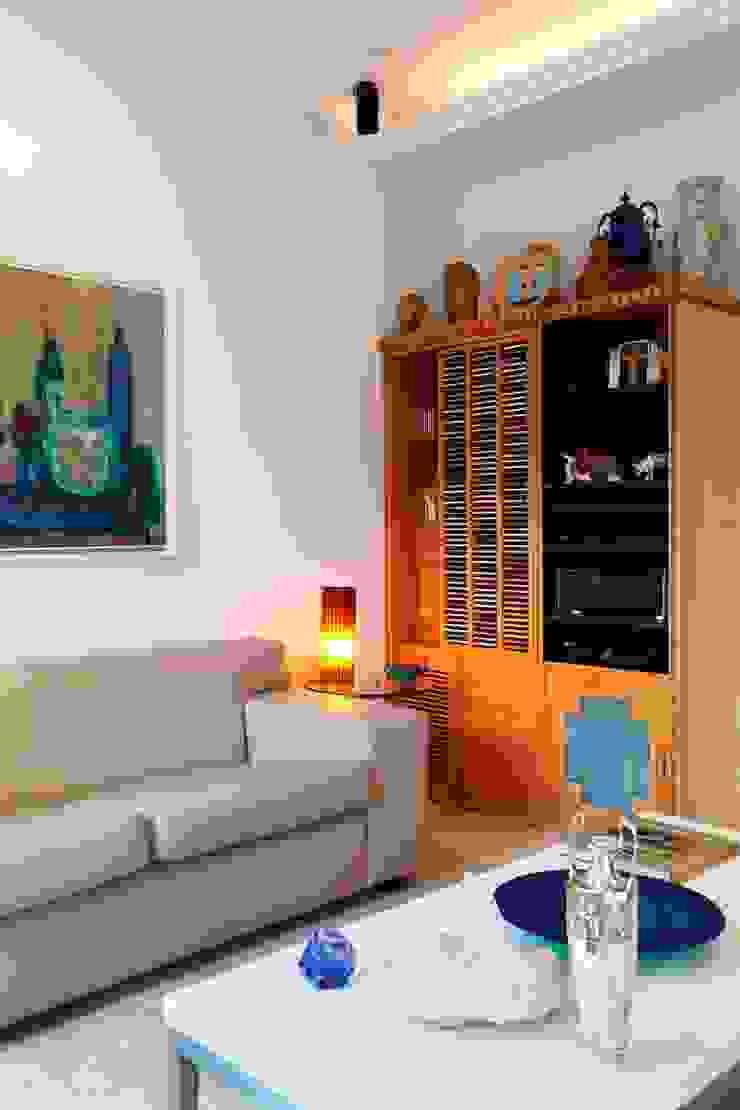 Apartamento Ipanema 3 Salas multimídia ecléticas por Carlos Salles Arquitetura e Interiores Eclético