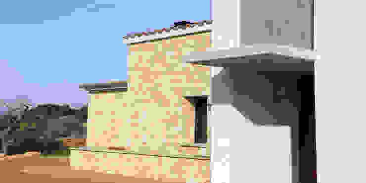 VIVIENDA UNIFAMILIAR AISLADA Y PISCINA EN ALGAIDA JAIME SALVÁ, Arquitectura & Interiorismo Casas de estilo rústico Piedra