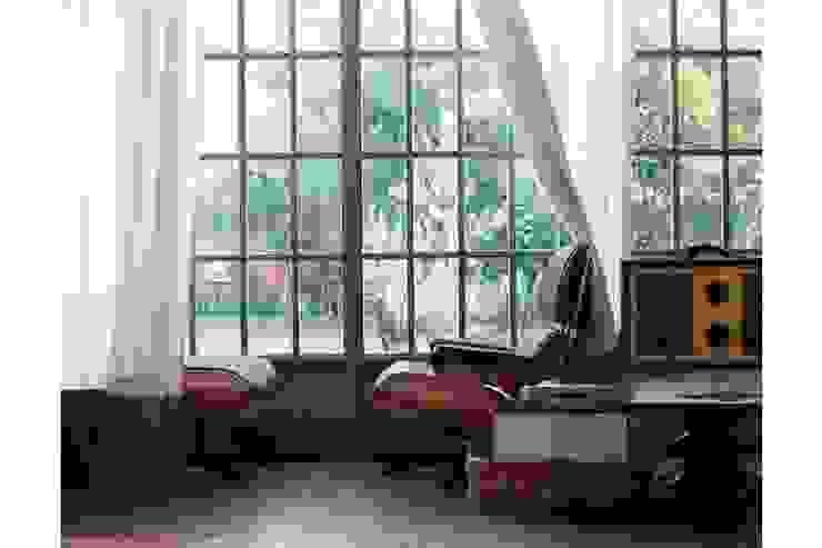 Lounge Chair & Ottoman de VITRA de Interiortime Moderno