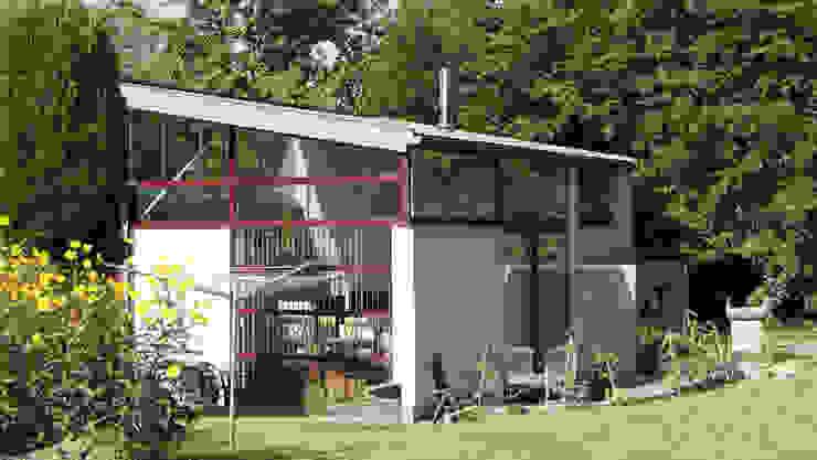 Maison sur un talus Maisons modernes par VORTEX atelier d'architecture Moderne