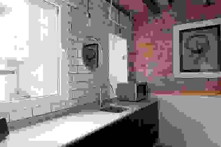 Cozinhas modernas por Brick Serveis d'Interiorisme S.L. Moderno
