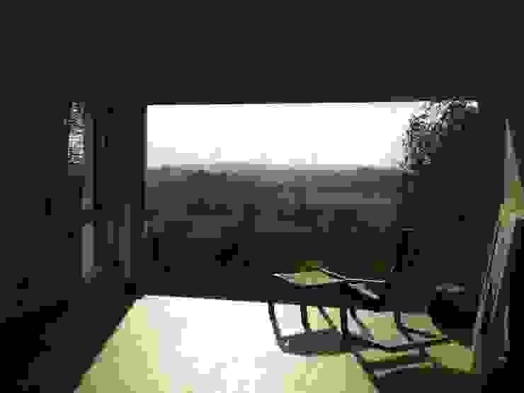 Modern Living Room by homify Modern Glass