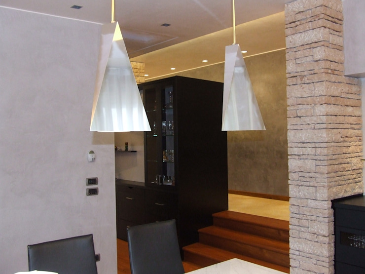 STUDIO DI ARCHITETTURA VERGILIO BURELLO Modern dining room Stone Multicolored