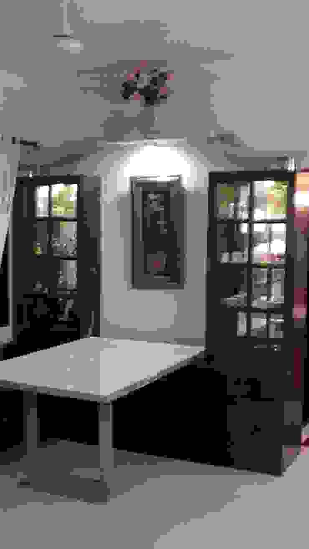 Miyapur Apartment Modern dining room by wynall interiors Modern