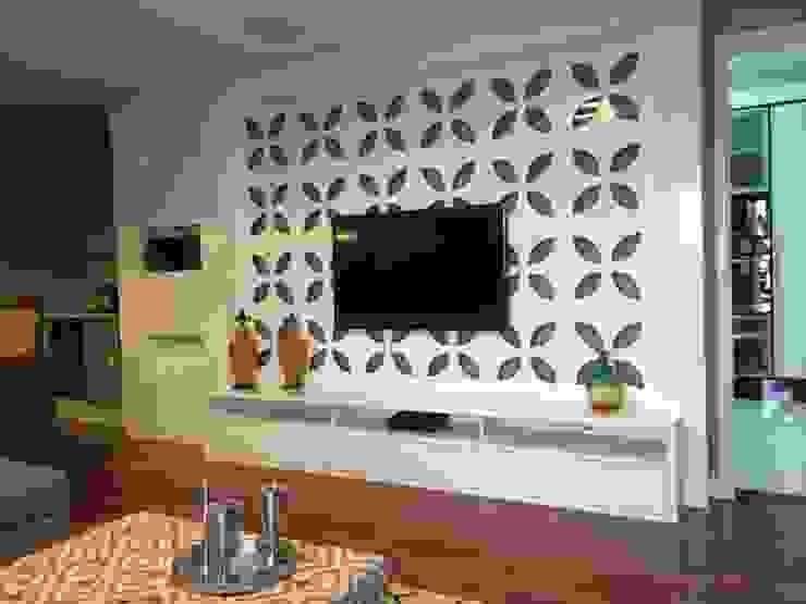 Painel da TV Salas de estar modernas por Padoveze Interiores Moderno