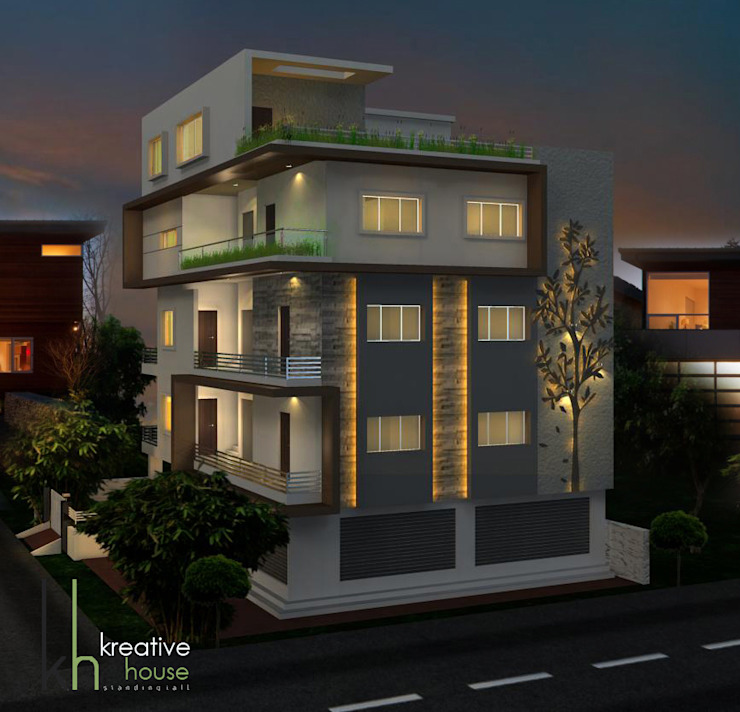 AN INDEPENDENT HOME WITH ELEGANT EXTERIORS (Night View) Eclectic style houses by KREATIVE HOUSE Eclectic Stone