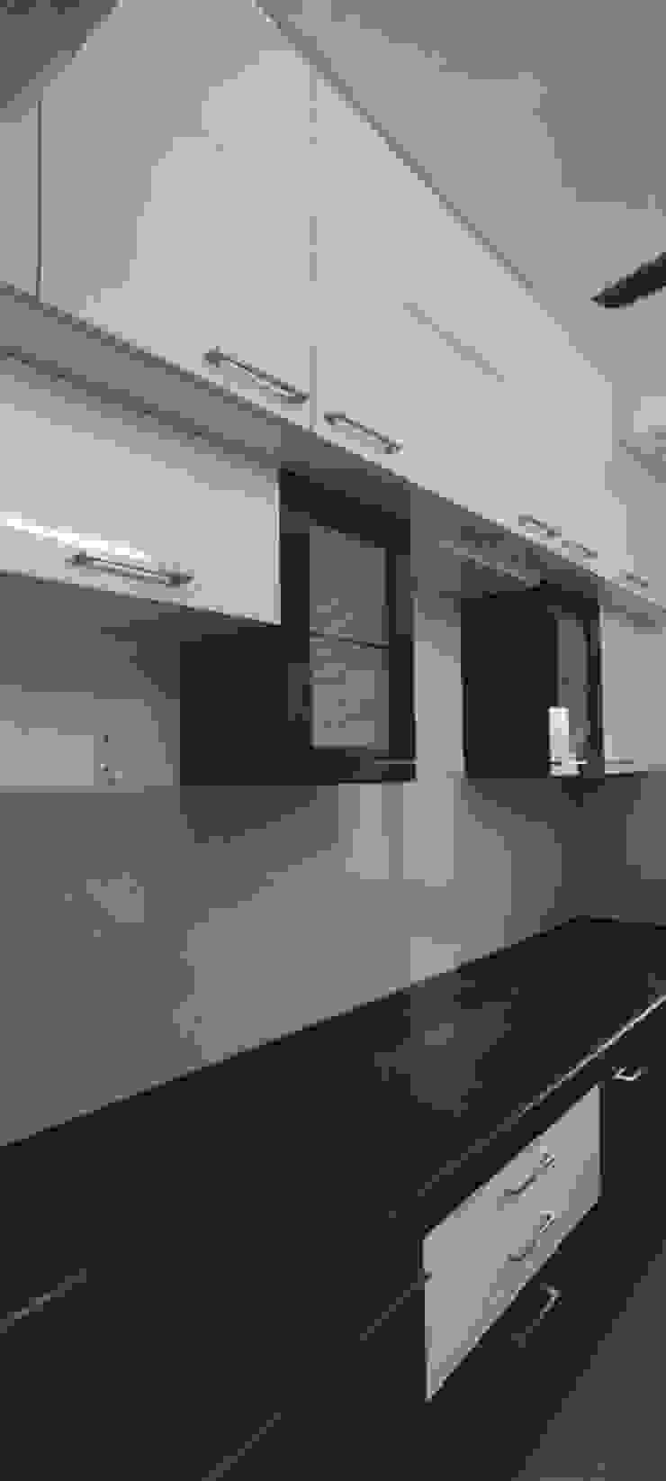 Thane Apartment. Modern kitchen by The design house Modern
