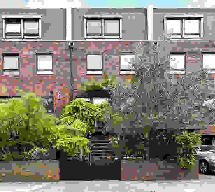 Mews elevation Minimalist houses by homify Minimalist Bricks