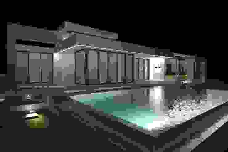 Vivienda Moderna con piscina de borde oculto de DYOV STUDIO Arquitectura, Concepto Passivhaus Mediterraneo 653 77 38 06 Mediterráneo Piedra