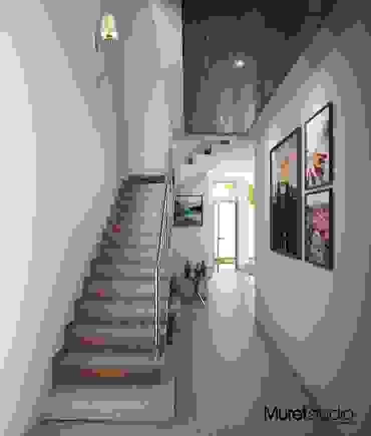 La Casa Osmio Pasillos, vestíbulos y escaleras modernos de Muret Studio Moderno