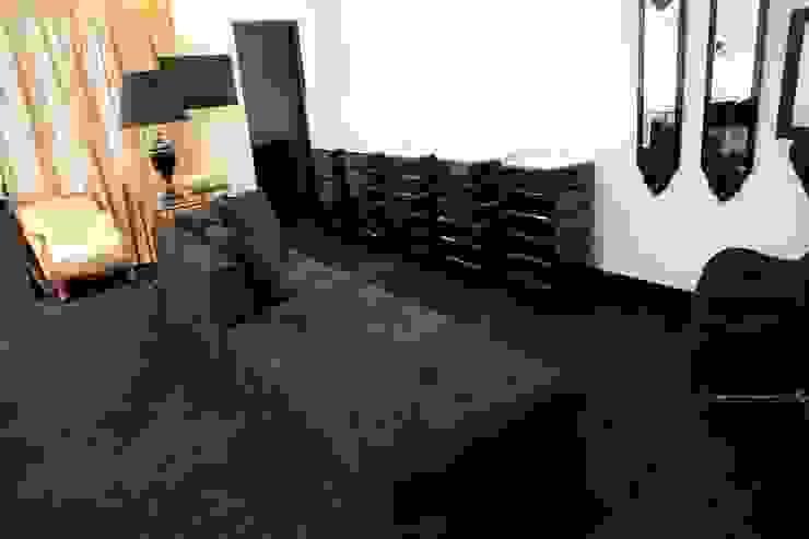 Lounge + Expositores Espaços comerciais clássicos por Piloni Arquitetura Clássico