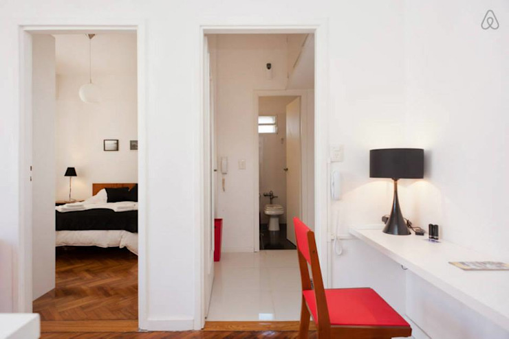 Larrea Apartamento Livings modernos: Ideas, imágenes y decoración de Ballesteros | Arquitectos Moderno