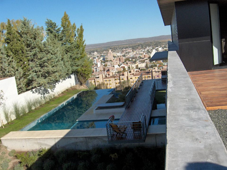 Casa en Barrio Gamma Casas modernas: Ideas, imágenes y decoración de aercole Moderno
